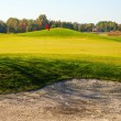 Стоковое фото: Green of golf course with cup and bunkers