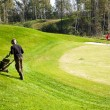 Man Mowing Lawn on golf course using Lawn-Mower — Foto de Stock
