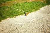 Sand bunker on the golf course with grass — Foto de Stock