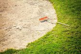 Sand bunker on the golf course with grass — Stock Photo