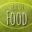 Healthy food on green grass poster illustration of healthy eating — Stock Photo