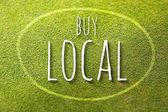 Buy local on green grass poster illustration of business — Stock Photo