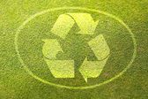 Recycling symbol on green grass poster illustration of eco-friendly life — Stock Photo