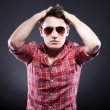Handsome young man with sunglasses hands on head — Stock Photo