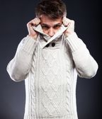 Young man in white sweater shivering from cold — Stock Photo