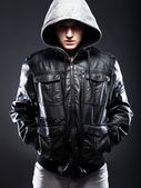 Young man in leather jacket with hood — Stock Photo