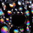 Soap bubbles abstract colorful background vibrant color — Stock Photo