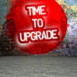 Stock Photo: Graffiti wall withTime to upgrade message, urbart