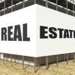 Stock Photo: Real estate on scaffold, advertising billboard