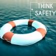 Think Safety sign, lifebuoy rough water waves — Stock Photo