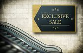 Moving escalator stairs with exclusive sale — Stock Photo