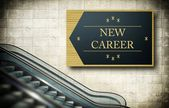 Moving escalator stairs with new career — Stock Photo