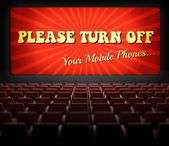 Please turn off cell phones movie screen in old cinema — Stock Photo