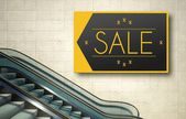 Moving escalator stairs with sale advertising — Stock Photo