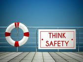 Think Safety sign at the swimming pool, lifebuoy — Stock Photo
