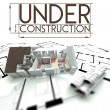 Under construction sign, project of house on blueprints — Stock Photo