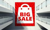 Big sale poster on wall in store interior — Stock Photo