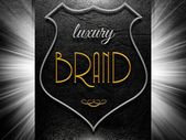 Luxury Brand sign on black leather — Stock Photo