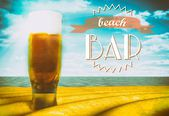 Beach bar sign, beer glass on sand — Stock Photo