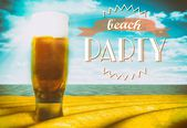 Beach party sign, beer glass on sand — Stock Photo