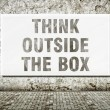 Think outside the box, words on wall — Stock Photo