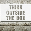 Stock Photo: Think outside the box, words on wall