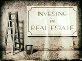 Investing in real estate on wall — Stock Photo