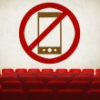 Please turn off cell phones symbol on screen in old cinema — Stock Photo #40799409