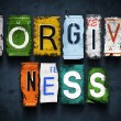 Forgiveness word on vintage broken car license plates — Stock Photo #40954739