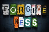 Forgiveness word on vintage broken car license plates — Stock Photo