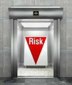 Business risk. Modern elevator with red down arrow — Stock Photo