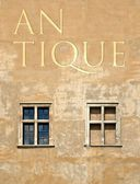 Antique word on old building wall — Stockfoto