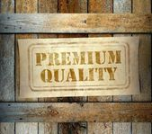 Stamp Premium Quality label old wooden box — Stock Photo