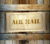 Stamp Air Mail label old wooden box — Stock Photo