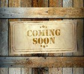 Stamp Coming Soon label old wooden box — Stock Photo