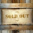 Stamp Sold Out label old wooden box — Stock Photo