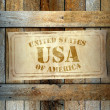 Stamp USA label old wooden box — Stock Photo