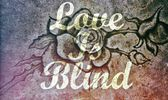 Love is Blind message stone rose background — Stock Photo