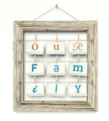 Old wooden photo frame Our Family inside — Stockfoto