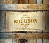 Stamp Bourbon label old wooden box — Stock Photo
