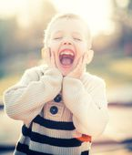 Smiling child portrait of little boy playing — Stock Photo