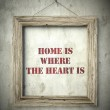 Home is where the heart is in old wooden frame — Stock Photo #45363183