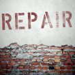 Repair concept on old brick wall — Stock Photo