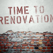 Time to renovation concept on old brick wall — Stock Photo