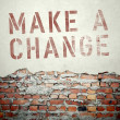 Make a change concept on old brick wall — Stock Photo