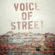 Voice of street concept on old brick wall — Stock Photo