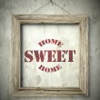 Home sweet home emblem in old wooden frame — Stock Photo #45365109
