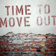 Time to move out concept on old brick wall — Stock Photo