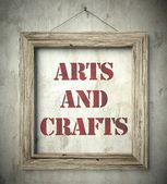 Arts and crafts in old wooden frame on wall — Stock Photo