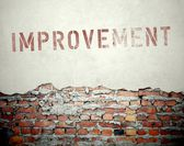 Improvement concept on old brick wall — Stock Photo